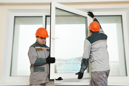 two workers installing window